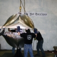 Lowering the top half of the times capsule which was welded